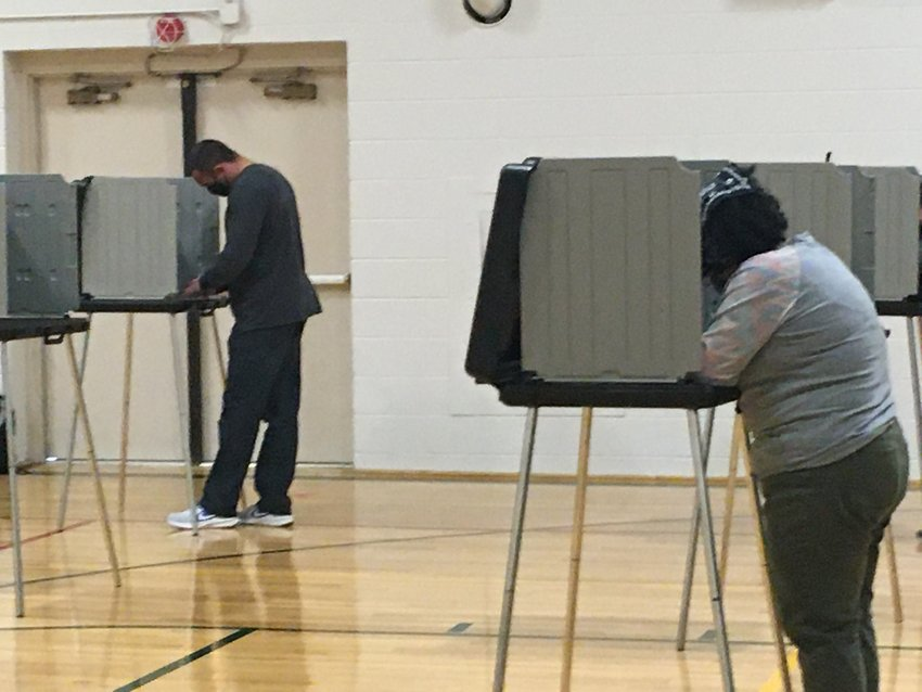 Voters cast their ballots at the East Lansing Community Center in East Lansing on Tuesday.