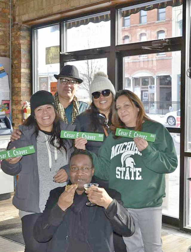 Mark Brown toasts the renaming of Grand River Avenue in Old Town as Cesar Chavez. With him (from left) areSol Garcia, Francisca Garcia and Natalia Reyes. In the back is Lorenzo Lopez.