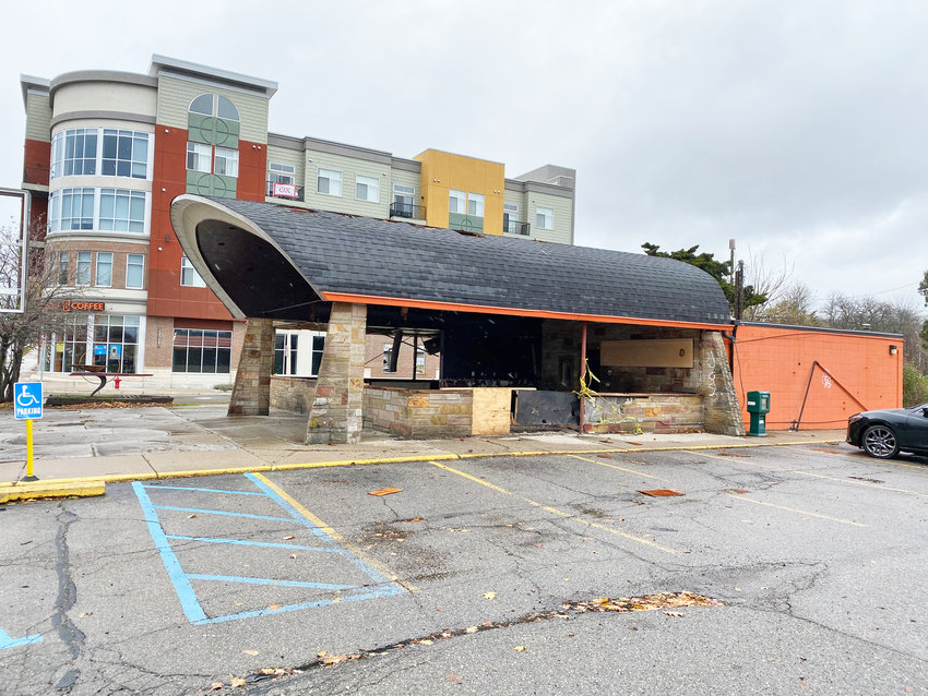 The original Biggby Coffee shop at 270 W. Grand River Ave. in Lansing as it appeared last month. To the left is Biggby's new home.
