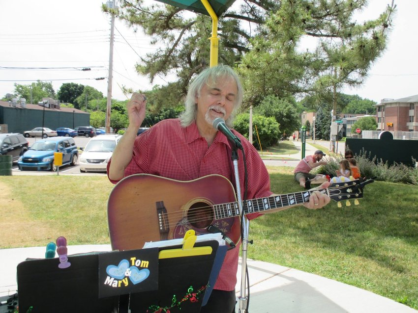 """Tom Heideman, writer of """"Singing Peace (A Christmas Song),"""" performing live."""