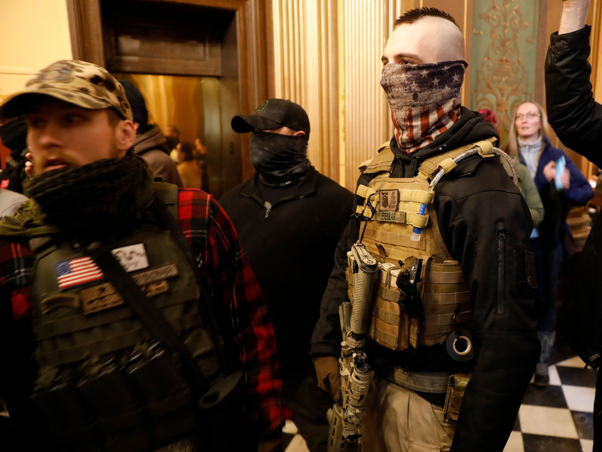 Armed militia members inside the state Capitol on April as part of a protest against Gov. Gretchen Whitmer's COVID-19 shutdown orders.