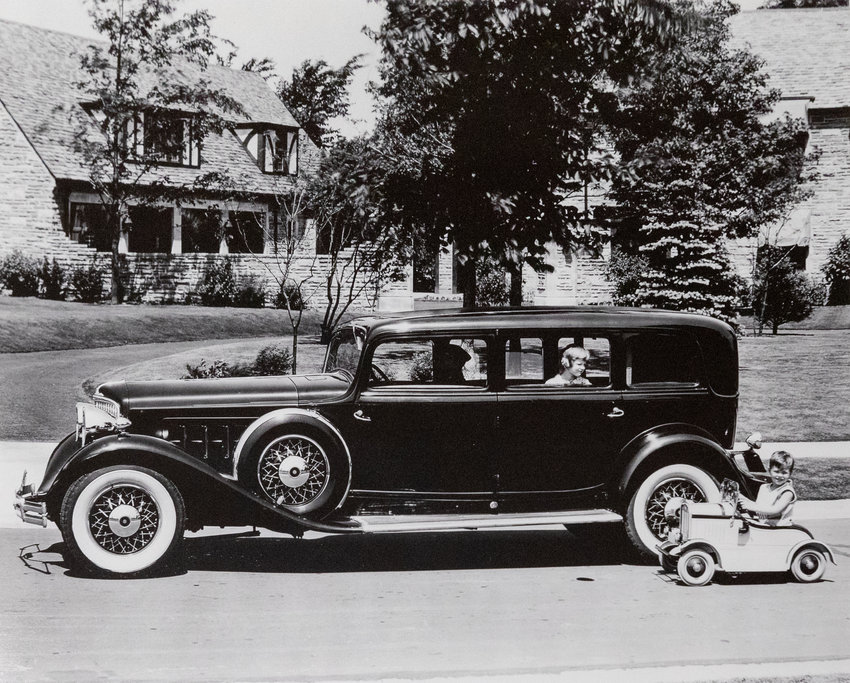 """A wealth of archival materials in the Broad Museum's """"Interstates of Mind"""" exhibit include this undated photo of an Oldsmobile in front of the Harper House in Lansing."""