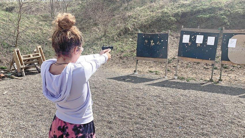 A Lansing woman trains at a local shooting range.
