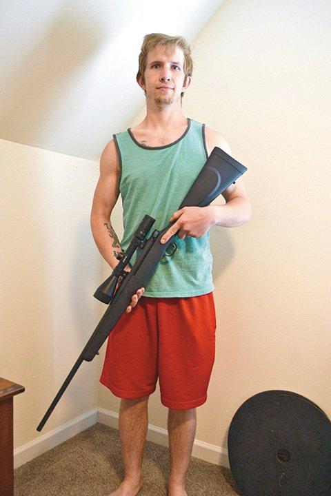 Dane Kowalk with his Mossberg hunting rifle.