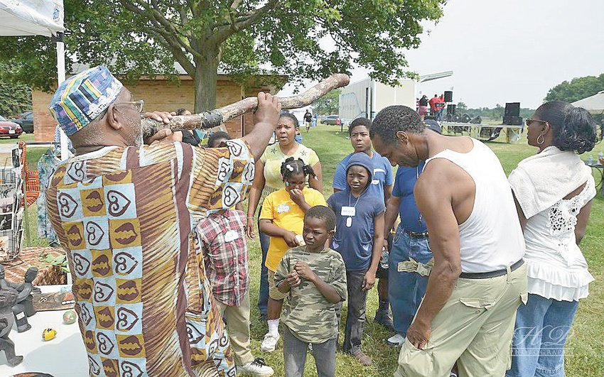 """Lansing educator and world traveler Willie Davis Jr. will be on hand at Saturday's Juneteenth celebration with artifacts from his """"All Around the African World Museum."""""""