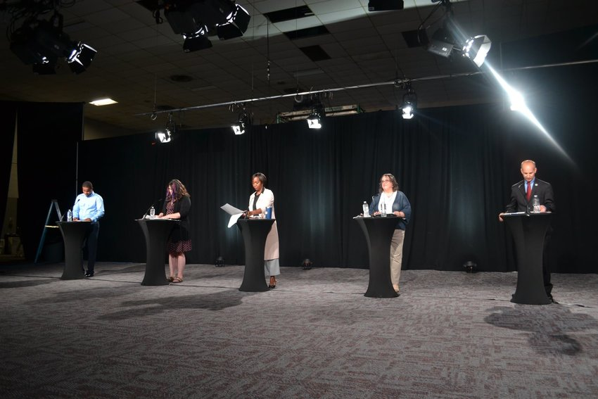 The five candidates at the City Pulse and FOX 47 News mayoral debate. (From left) Farhan Sheikh-Omar, Kathie Dunbar, Patricia Spitzley, Melissa Huber and Andy Schor.