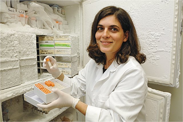 Dr. Irene Xagoraraki poses while showing samples from her ongoing monitoring of Detroit sewer systems.