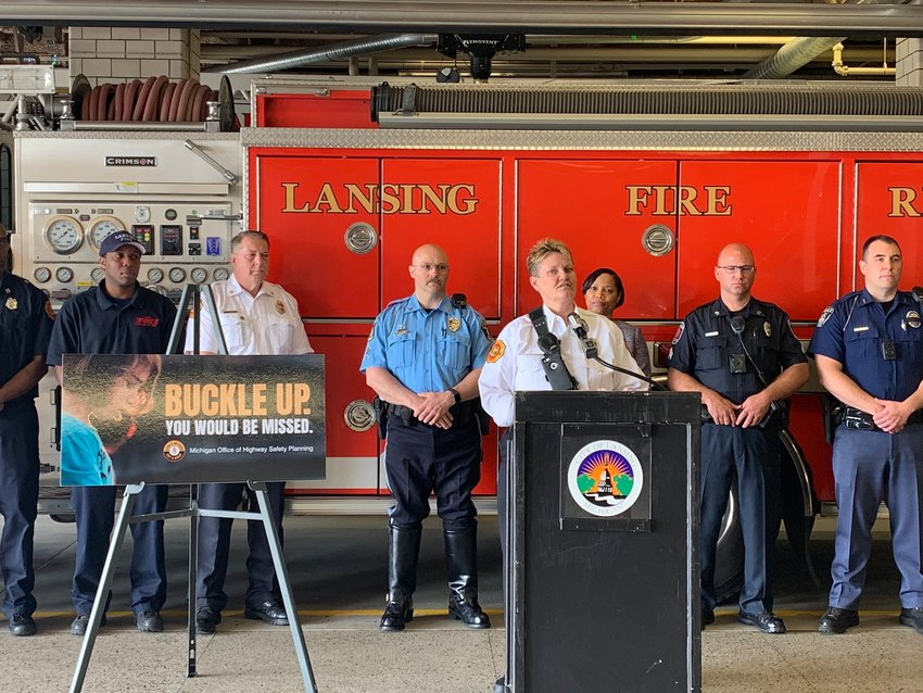 Former Lansing Fire Department Battalion Chief Shawn Deprez speaks at a press conference in 2019.