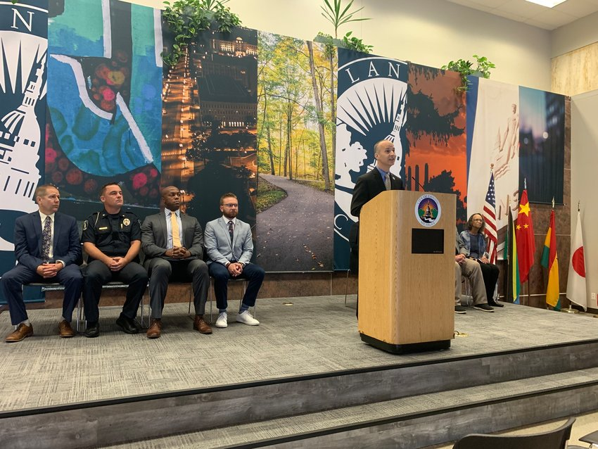 Lansing Mayor Andy Schor, seen Monday at a press conference, has budgeted $240,000 to help launch Advance Peace in Lansing. The program aims to intervene with violent teens.