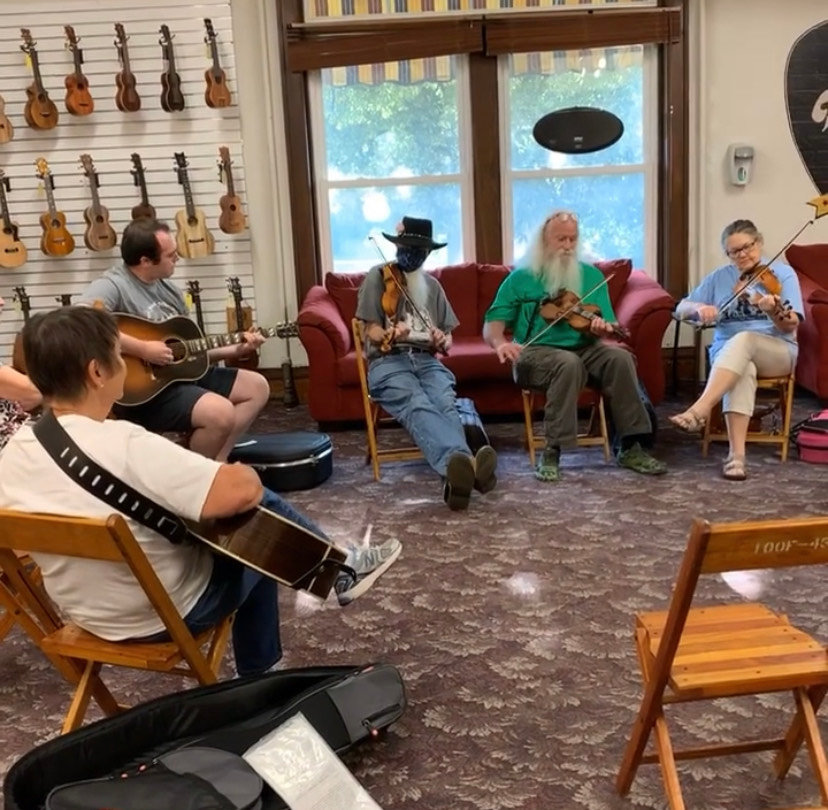 People gather for a jam session at Elderly Instruments during Arts Night Out on Aug. 13.