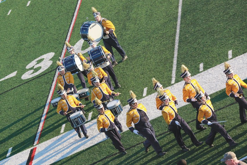 The Eastern High School Marching Band performing at a football game in 2019.