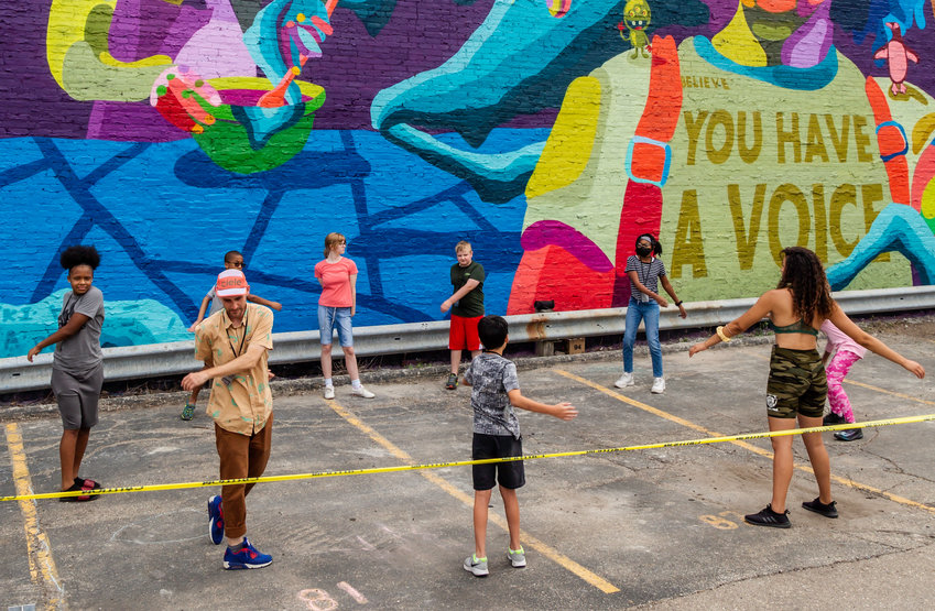 Dustin and students during a team-building exercise at the Grand Avenue mural.