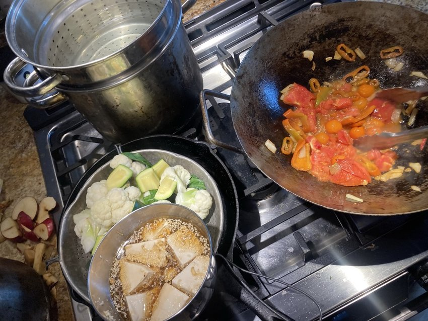 A stir-fry with tofu and fresh vegetables being prepared by Ari LeVaux.
