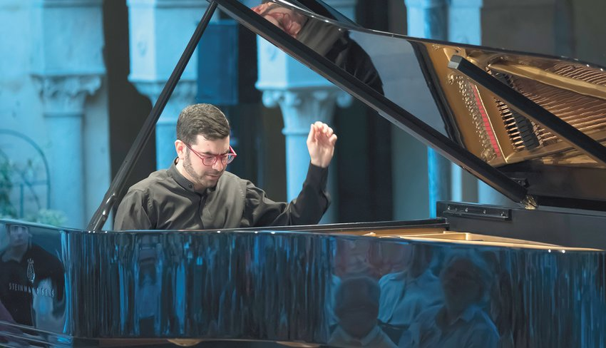 """Pianist Michael Brown, lauded by The New York Times as """"a young piano visionary,"""" will bring Tchaikovsky's epic Piano Concerto to life at the Lansing Symphony's first post-pandemic concert Saturday."""