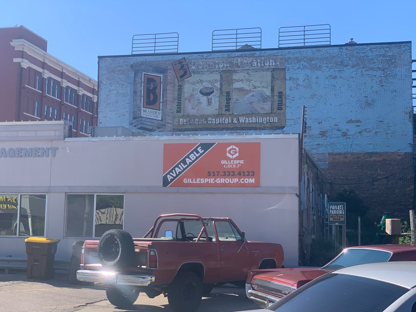 Some of the last remaining signage from Beaner's Coffee still adorns the top two floors a Kalamazoo Street law office.