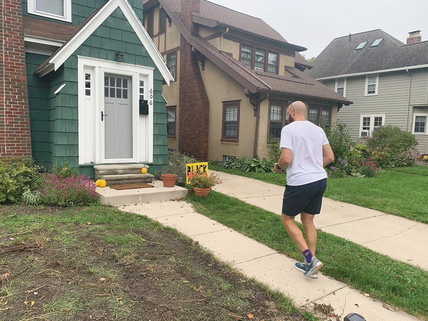 """Fourth Ward Councilman Brian Jackson stops at a house with a """"Black Lives Matter"""" sign while canvassing in the Westside Neighborhood on Oct. 7."""
