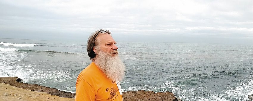 Rick Preuss surveys the Pacific Ocean during a break at a convention in San Diego.