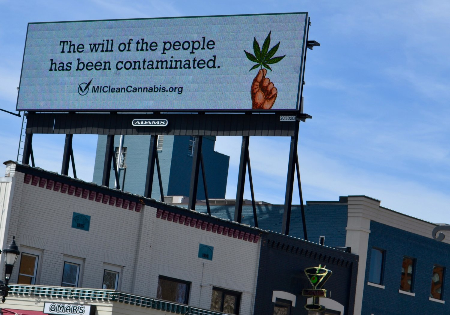 One of Green Peak Innovation's many billboards across Greater Lansing.