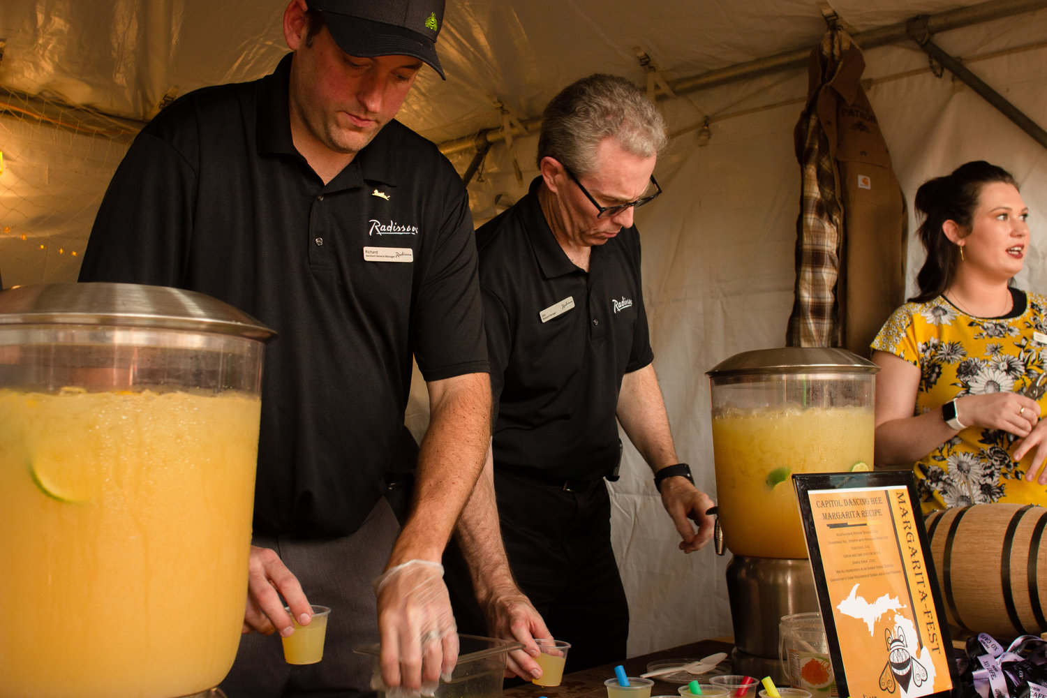 "Richard Ragainis and Jim Lanen serving the Radisson Hotel's ""Dancing Bee."""