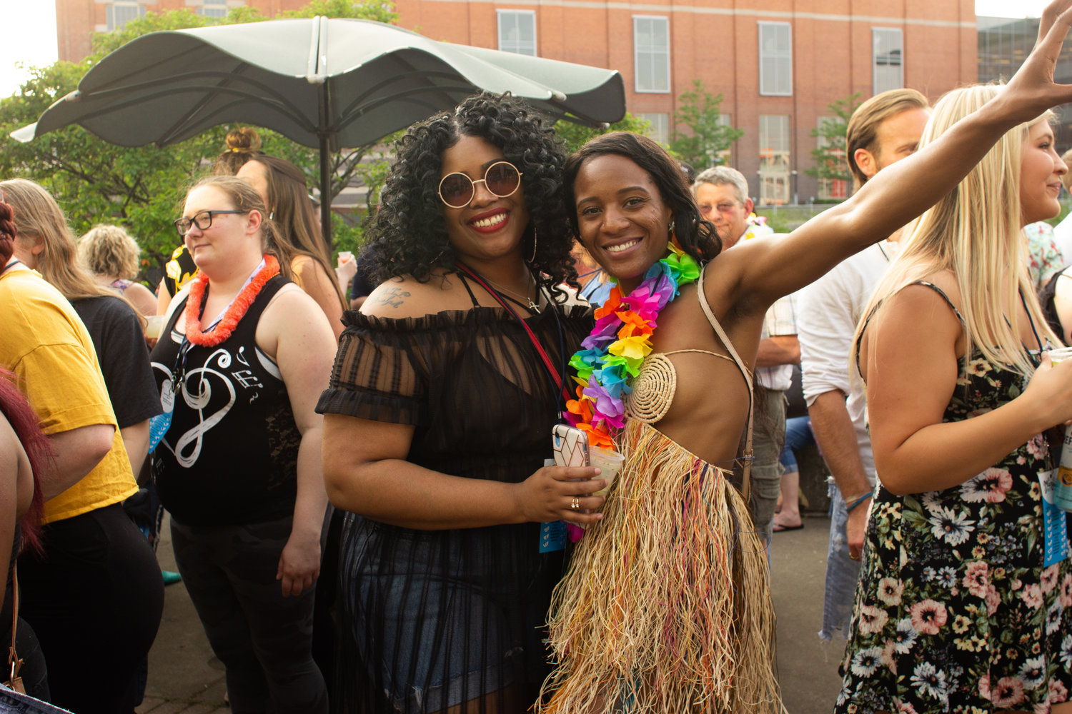 Sisters, Devontay and Johnell Clark, show off their individual take on beach party attire.