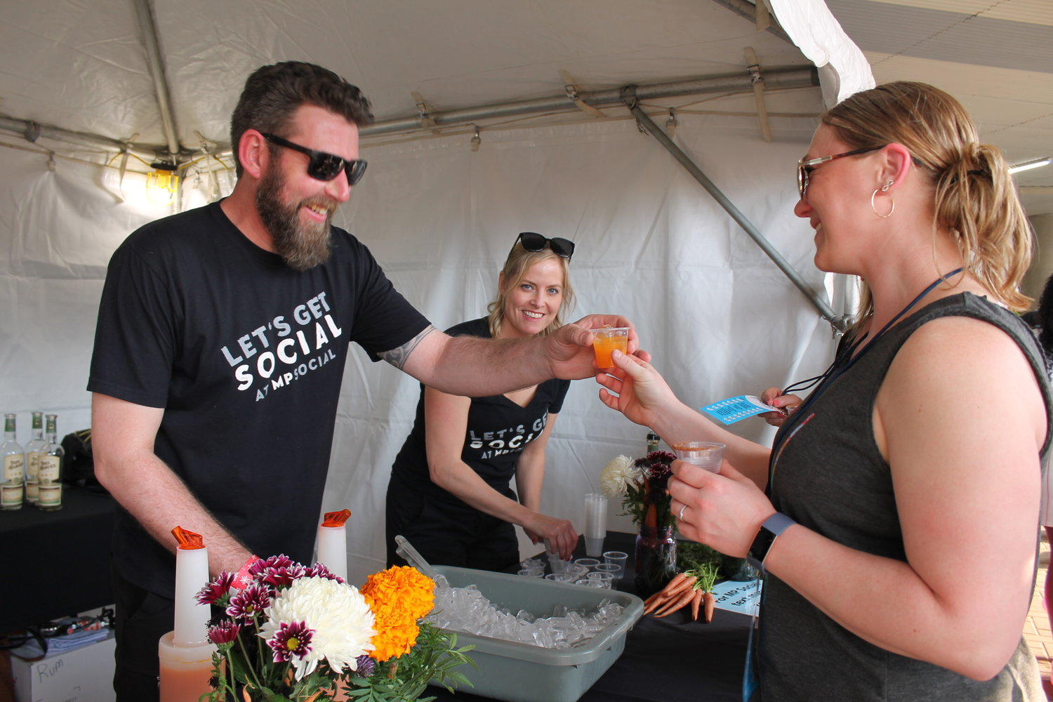 "Jeremy McKowen and Keri Brown serving ""24 Carrot Gold"" at MP Social's booth."