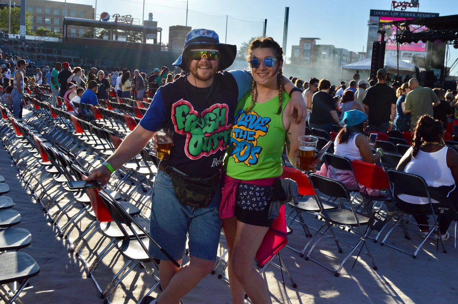 Trey Rudloff (left) and Brittney Kendziora brought back fanny packs and neon for Friday's concert.