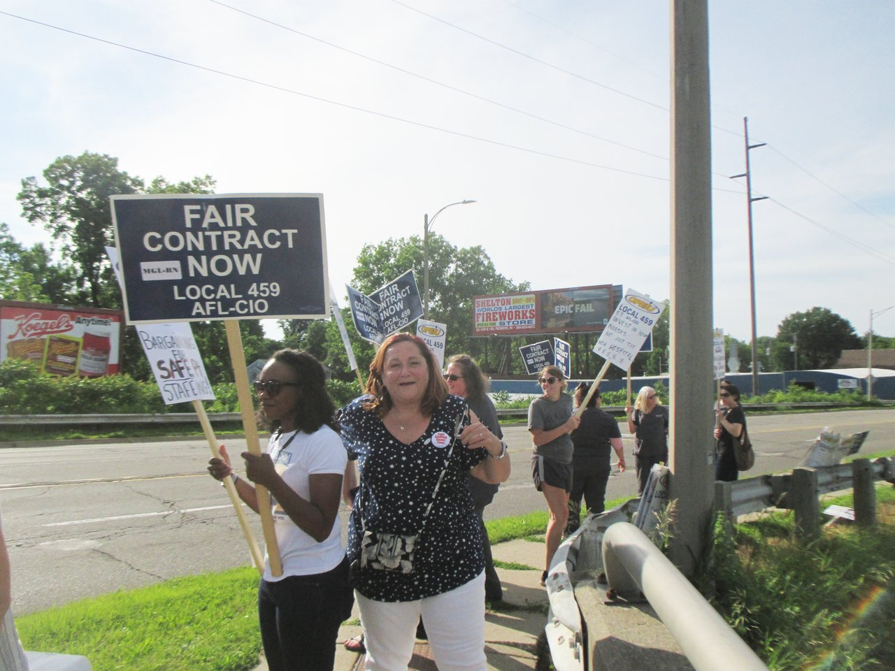 OPIEU Local 459 president Sharon Taylor pickets with registered nurses on Pennsylvania Avenue outside McLaren Orthopedic Hospital.