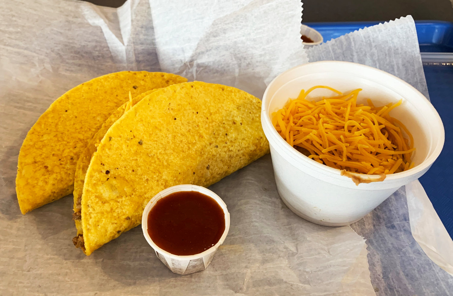 Two hard shell tacos with a side of beans from Mr. Taco.