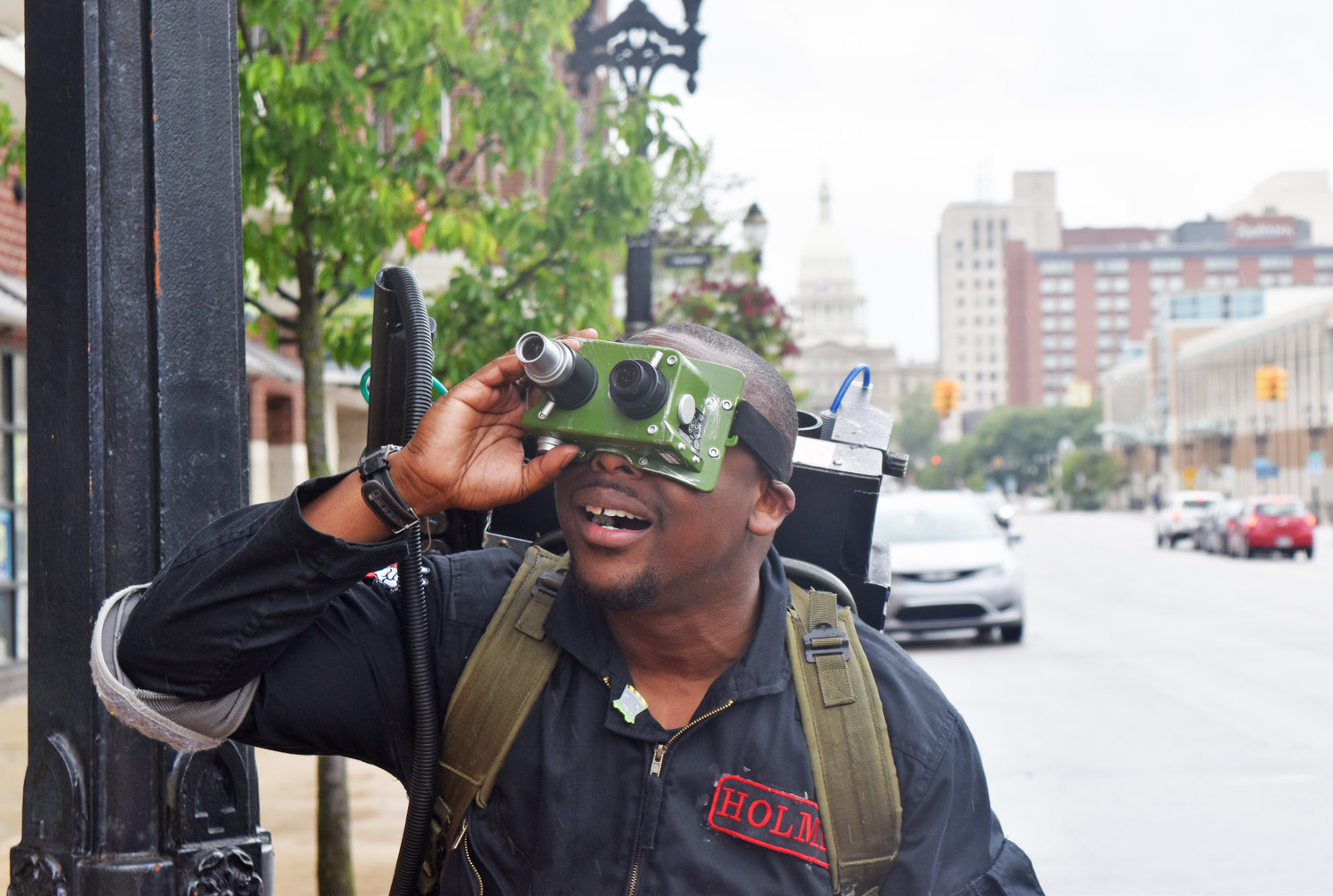 Lansing Ghostbuster Ryan Holmes dons his Ecto Goggles to search for the paranormal on Michigan Avenue.