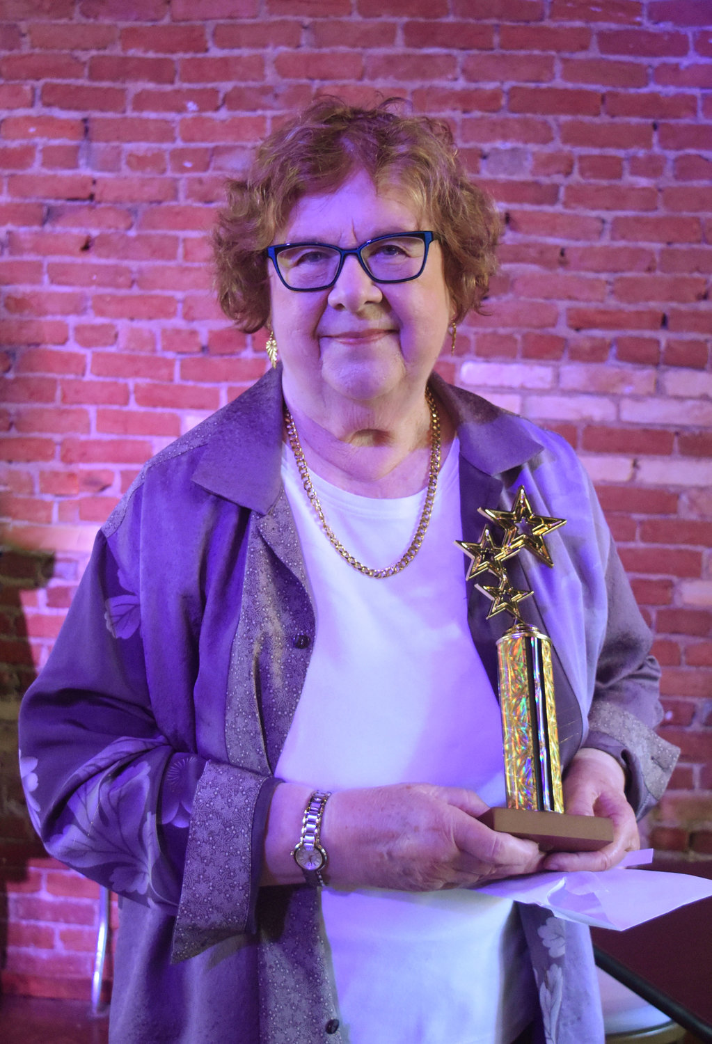 "Susan Chmurynsky, the director of ""These Shining Lives,"" accepted the award for Best Play."