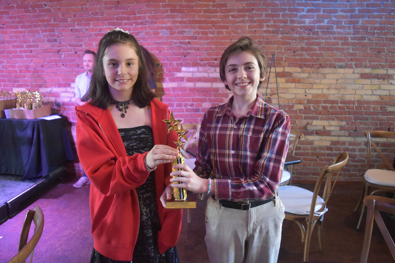 Isabella Edmonds-Hogan and Phineas Reed accepted the awards for crew members from Owosso Community Players that couldn't accept the award.