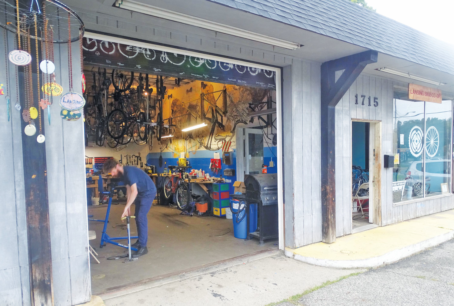 Alex Seddon hosted open shop hours at the Lansing Bike Co-op Monday.