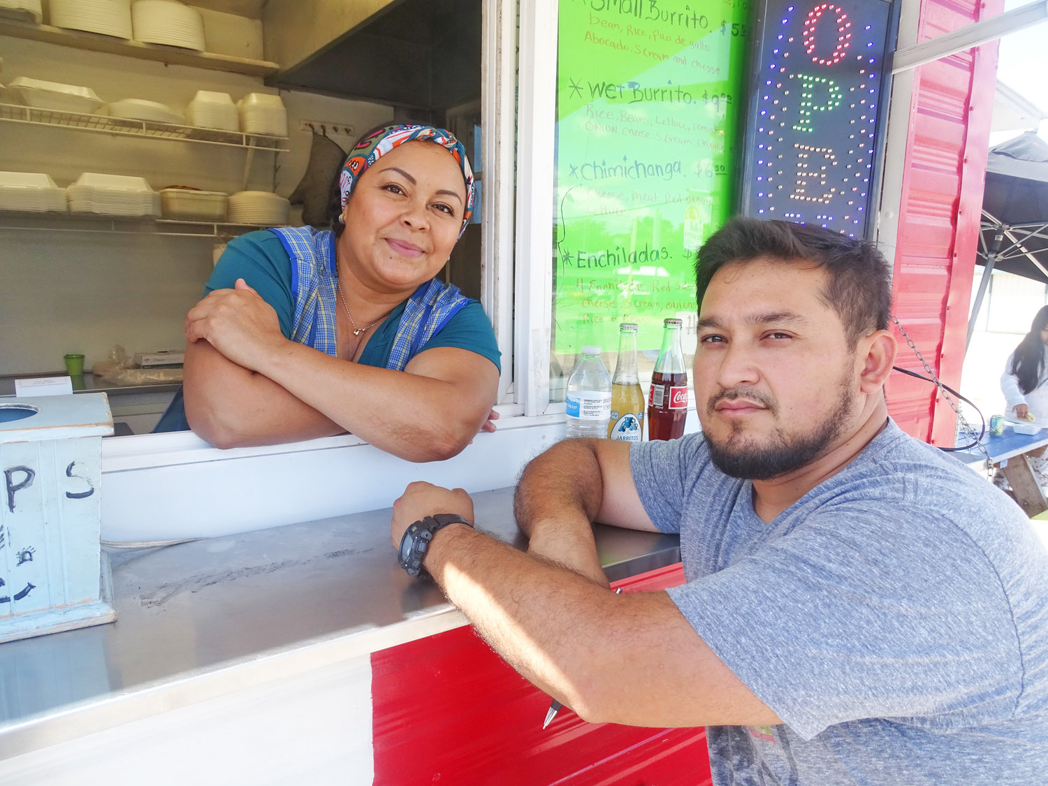 Maria Sotella and Juan Marquez of Maria's Cuisine food truck in north Lansing say they are more wary of their surroundings since the El Paso shooting.