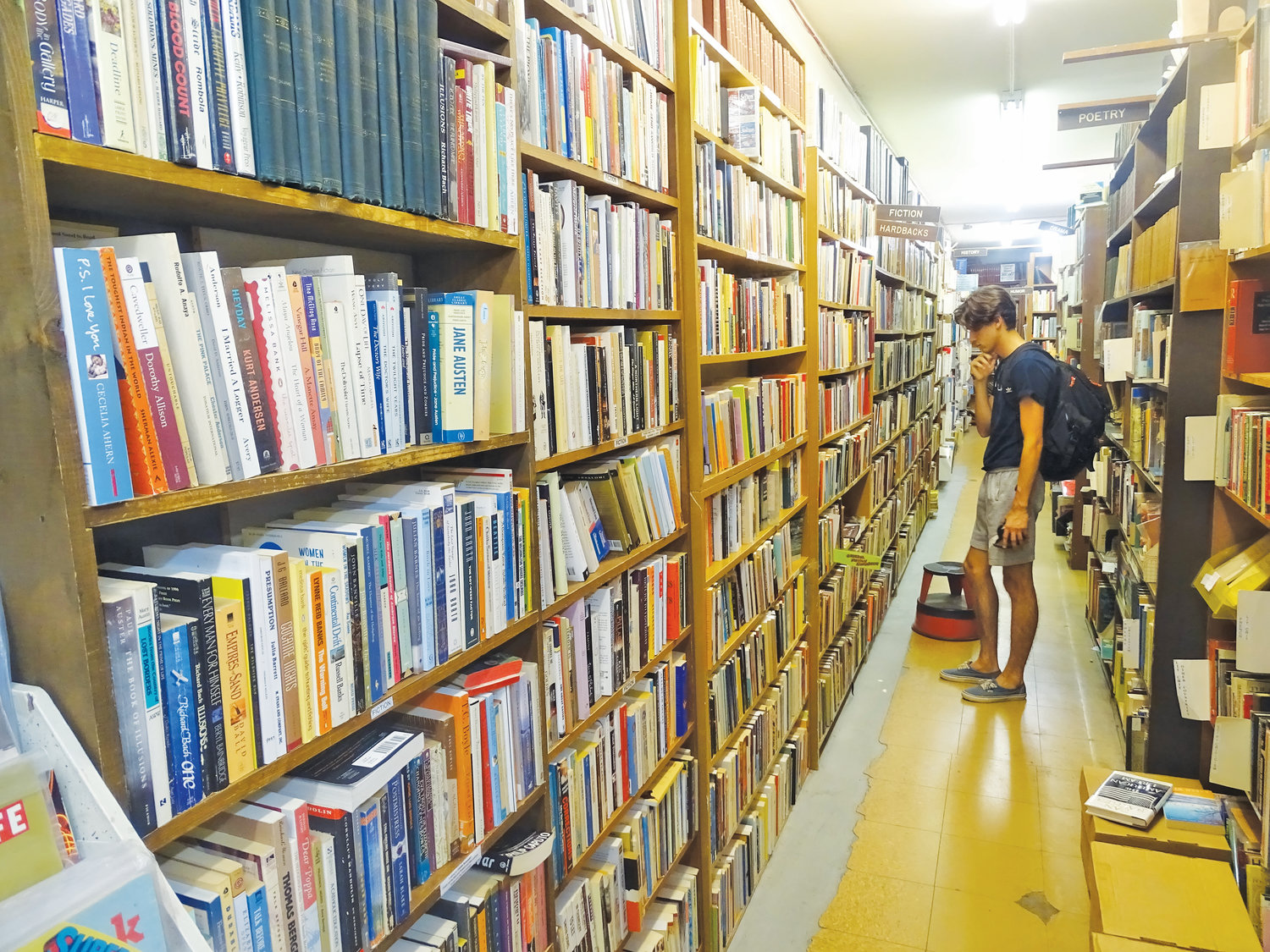 A customer sifts through Curious Book Shop.