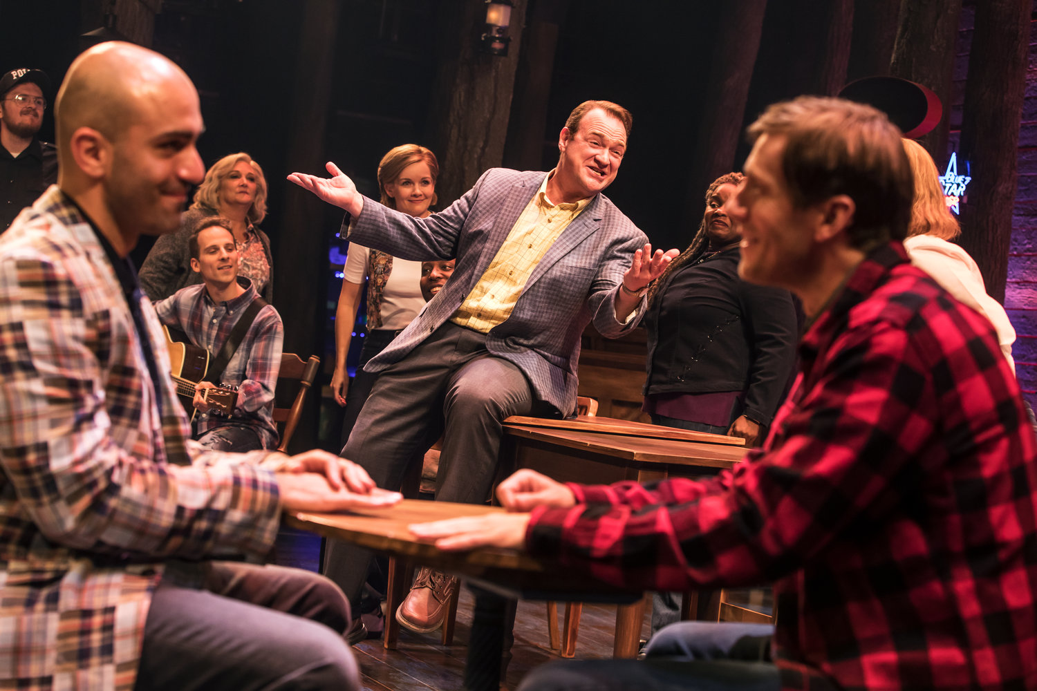 "Kevin Carolan (center) plays the jovial mayor of Gander, Newfoundland in ""Come from Away."""