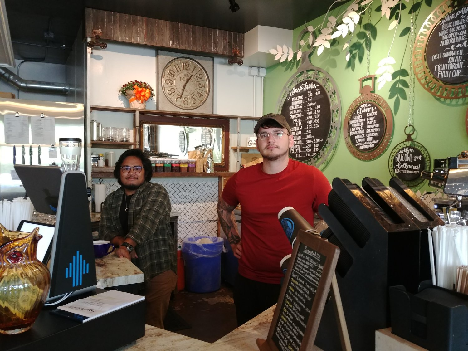 Barista Elijah Pickering (left) and manager Tyler Crosthwaite work the counter at Blue Owl's Old Town location.