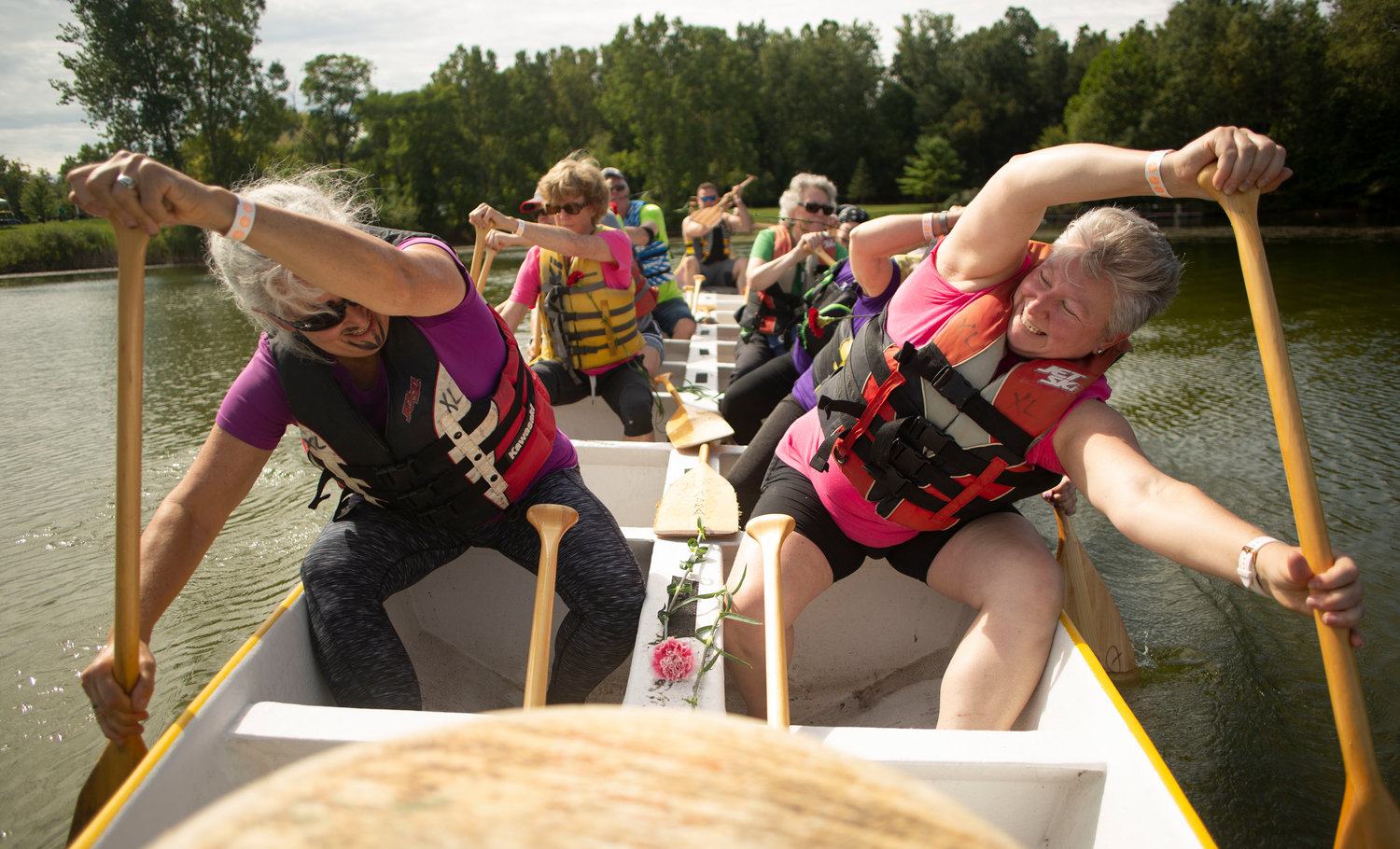 Ann Stanton (left) and Jennifer Summerville (right) lead the team to the center of the lake to release carnations in remembrance of those who have passed due to cancer, or are still fighting.