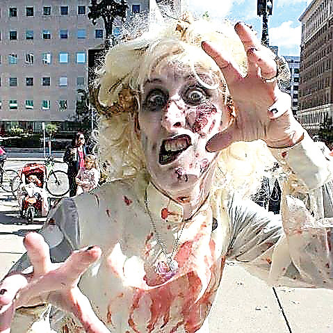 Lansing's Zombie Walk begins Sunday at 2 p.m. at the Lansing Center and functions as a food drive for the Greater Lansing Food Bank.
