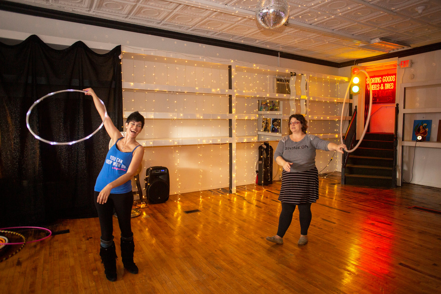 Nat Weaves (left) and Missy  Cooke encourage guests to take their hula hoops for a spin. Weaves teaches regular hoop classes at Cedar Street.