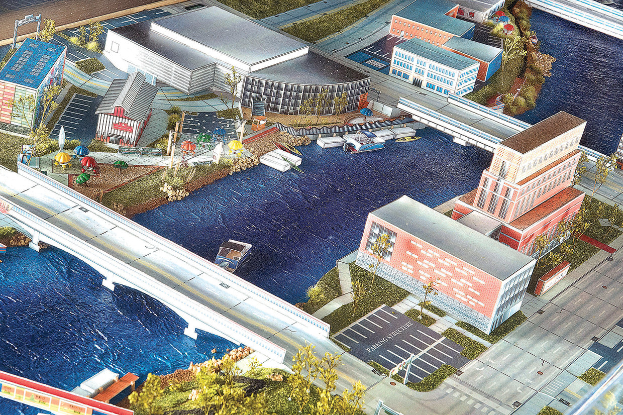 "A scale model of Lansing's riverfront sits in the offices of the Capital Area Community Foundation, the prime mover of Rotary Park and future projects meant to ""activate"" Lansing's riverfront."