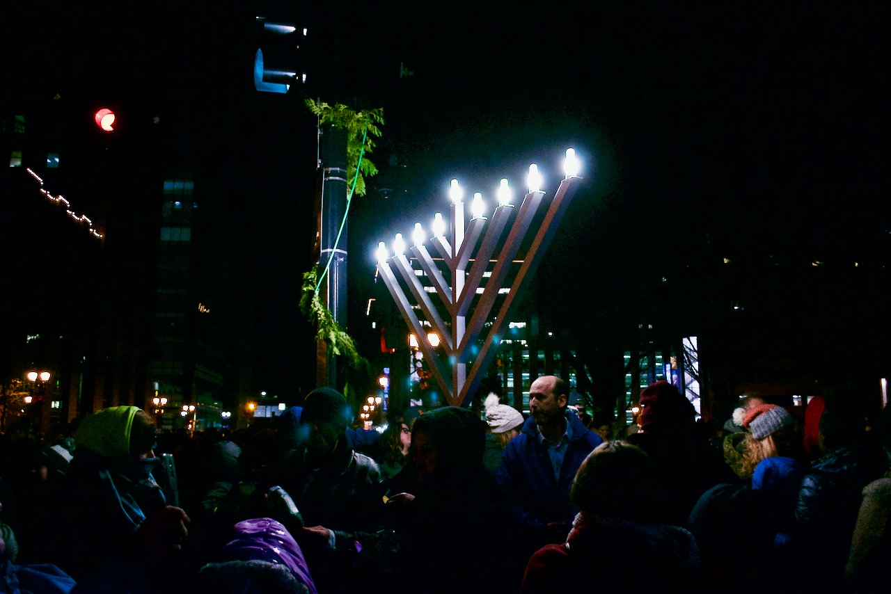 A menorah glows in the night at Silver Bells in the City.