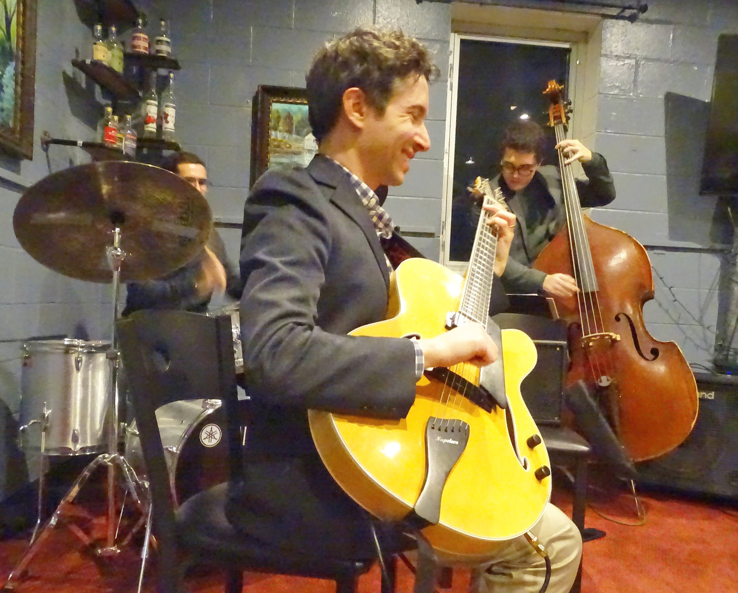 Guitarist Randy Napoleon brought his quartet to Red Cedar Spirits Thursday and will return Dec. 5. Joining Napoleon Thursday were Lucas Lafave (left, on bass), Will Crandall (drums) and Andre Crawford on piano (not pictured).