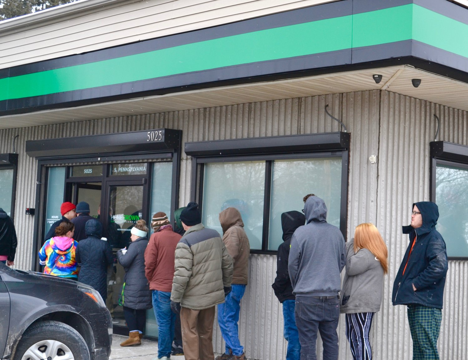 Customers line up outside of Homegrown Cannabis Co.