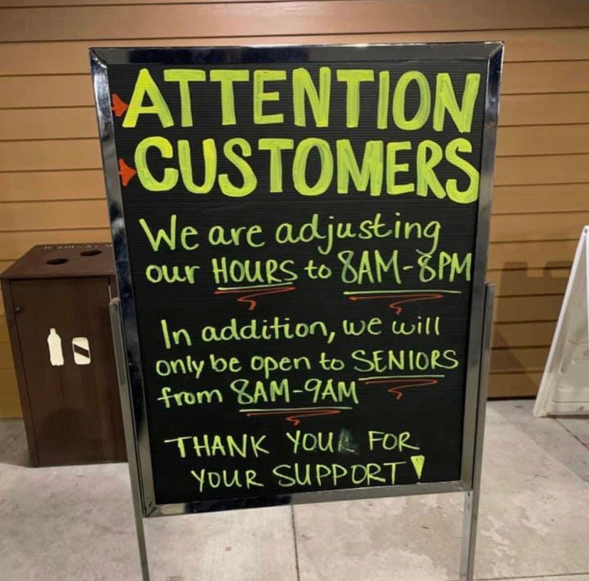 A sign notifying Whole Foods customers of special reserve hours for seniors. Taken at Whole Foods in East Lansing.
