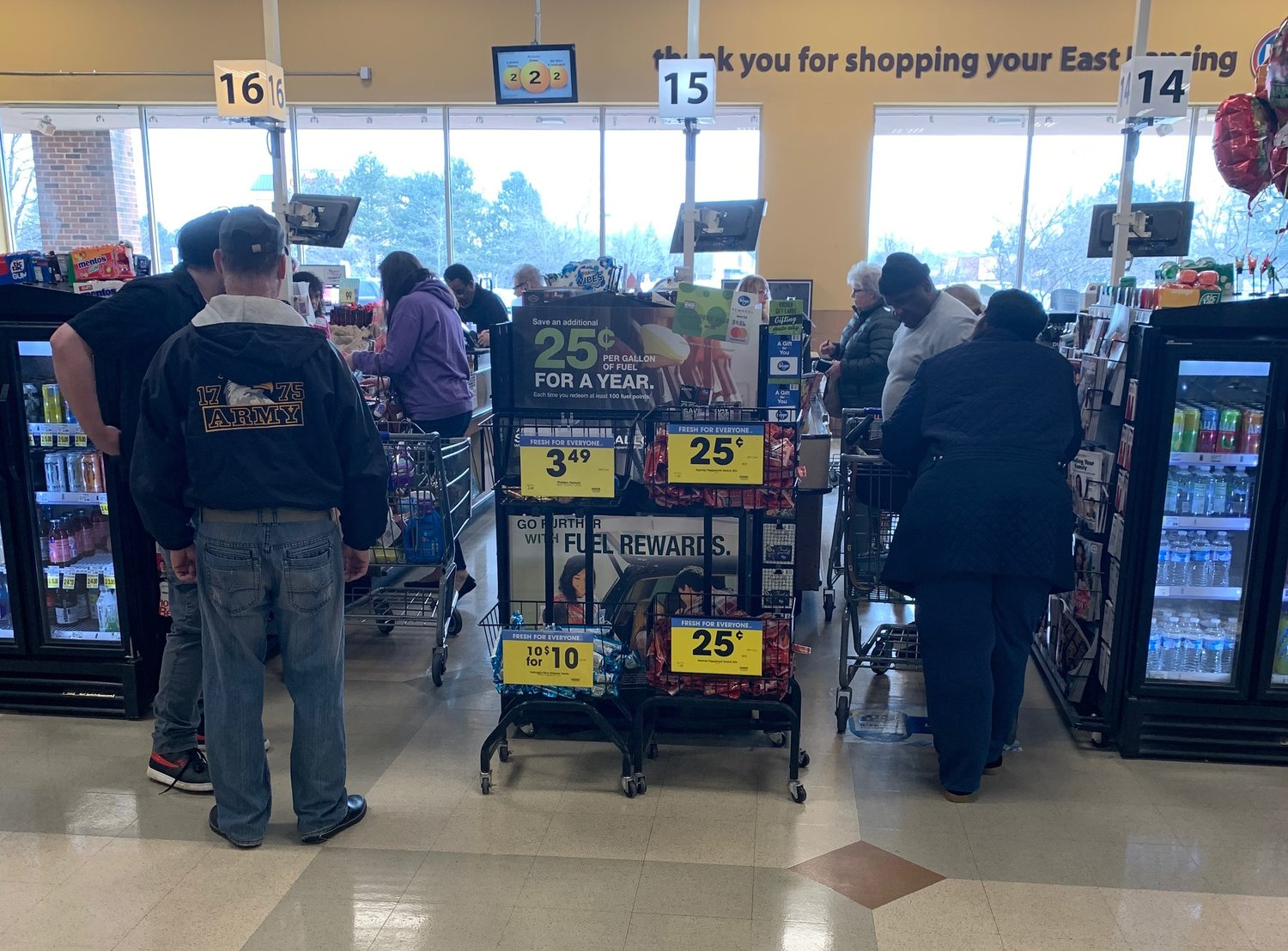 Several customers were standing closer than six feet apart at a Kroger in Lansing on Wednesday.