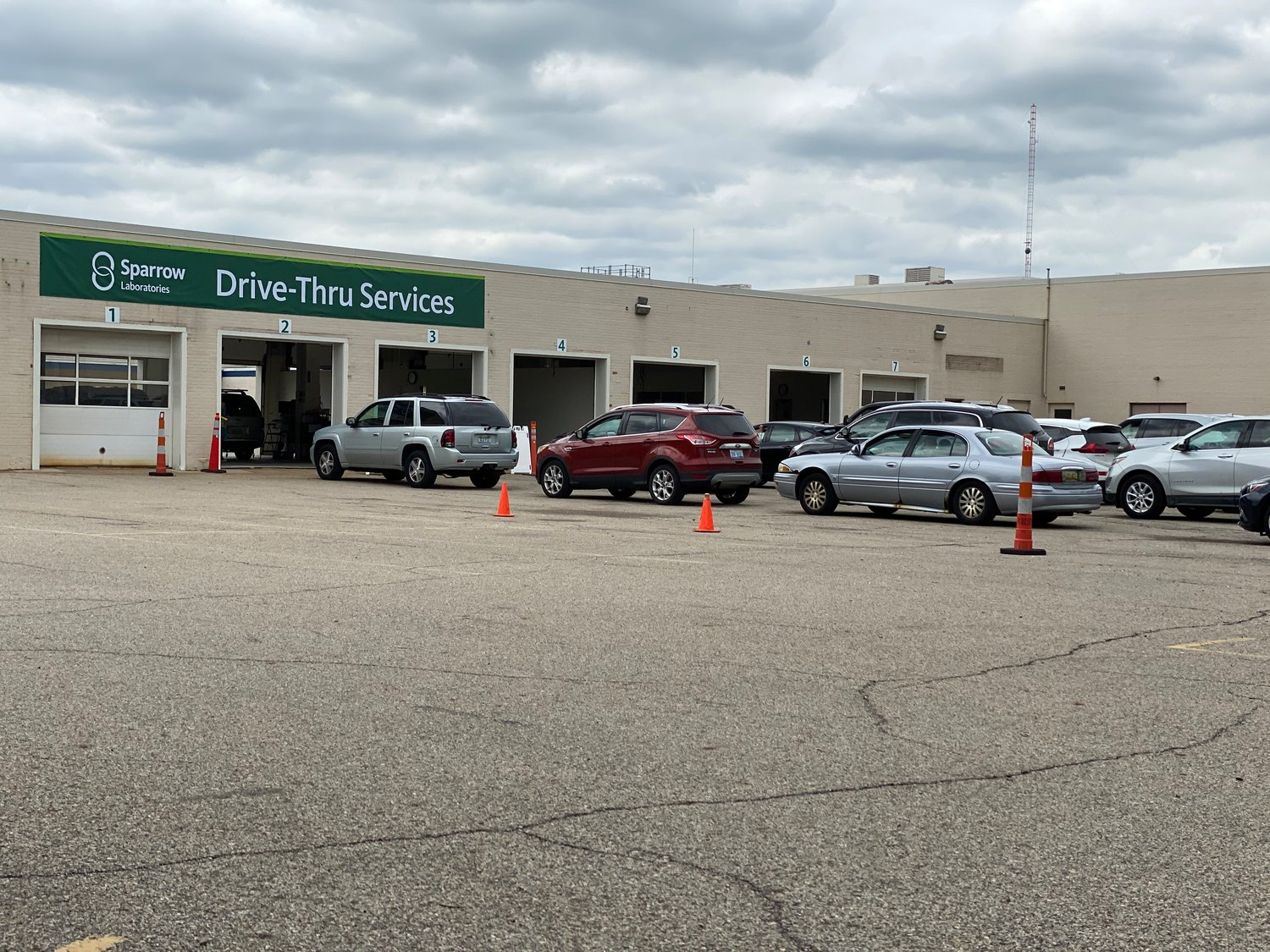 Cars were lined up today almost to Michigan Avenue at Sparrow Health System's new COVID-19 testing site in the old auto repair shop of Sears in Frandor.