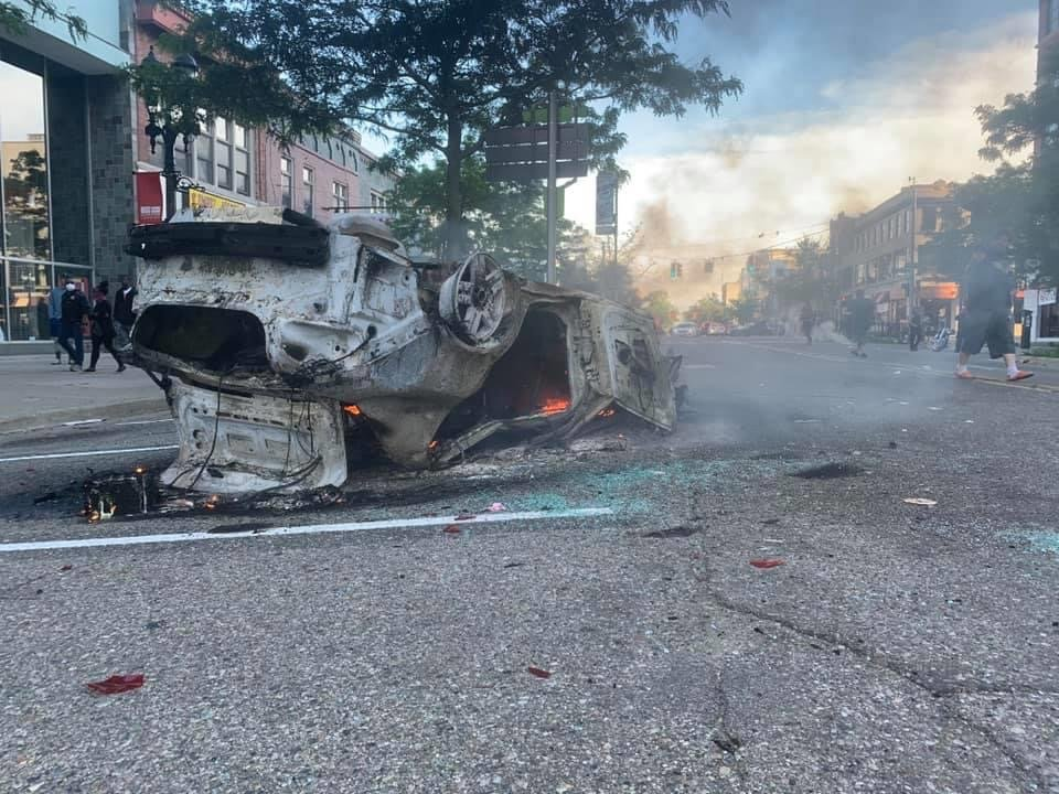 A car burns on Washington Square just south of Michigan Avenue.