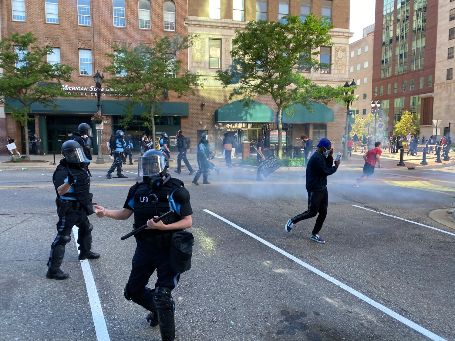 Police used tear gas after protesters burned a car on Washington Square.