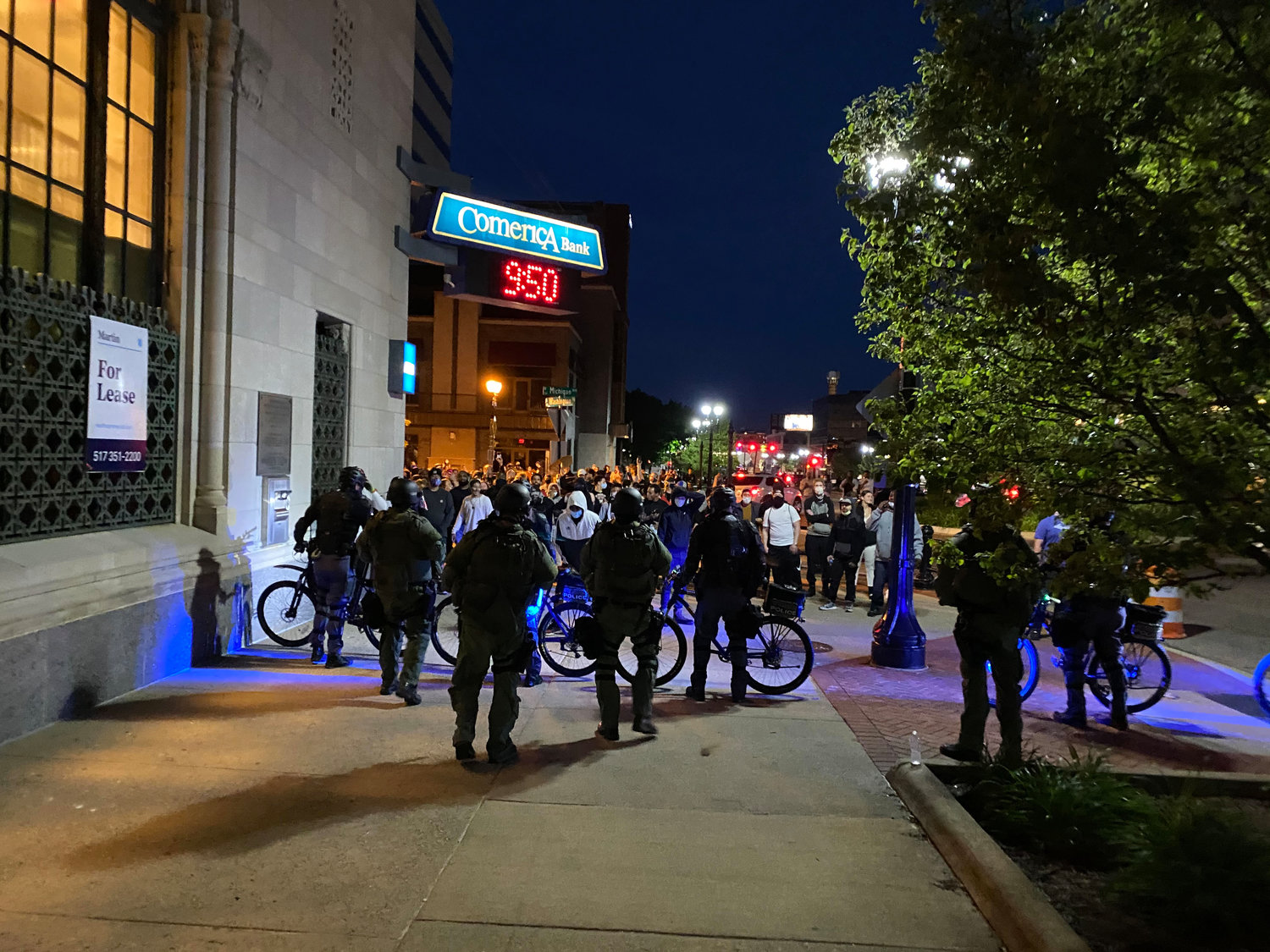Police in front of Comerica Bank late Sunday night.