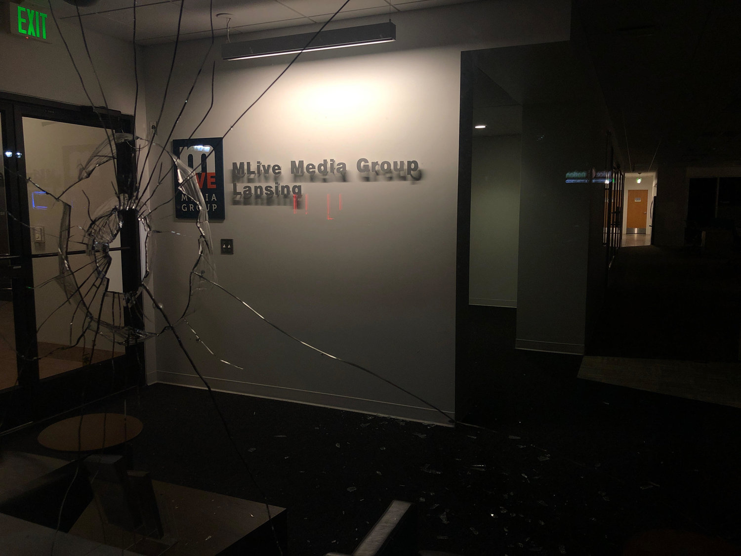 Smashed windows at MLive's downtown Lansing office.